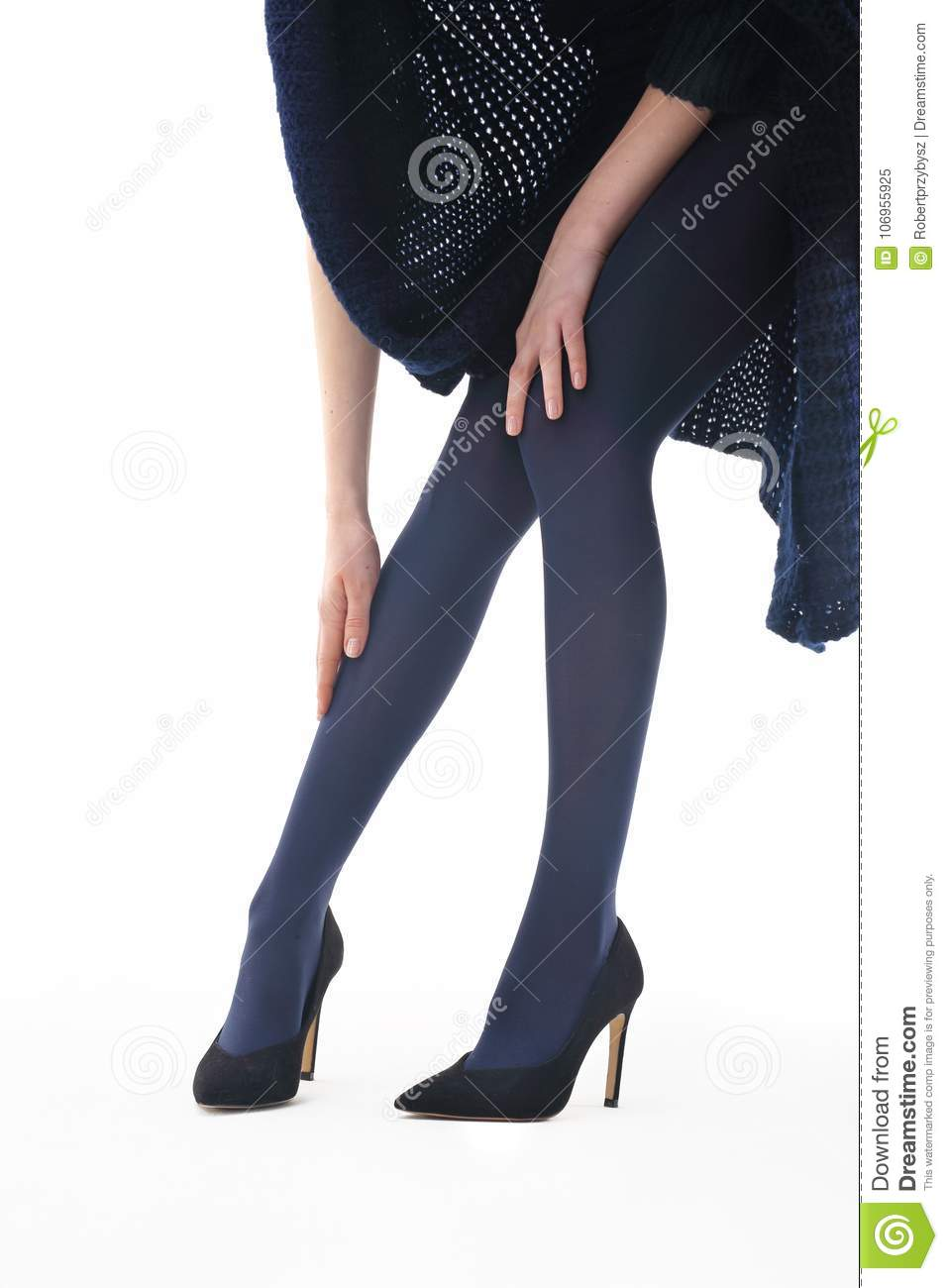 2f098973e Beautiful and shapely legs of a woman in opaque tights.
