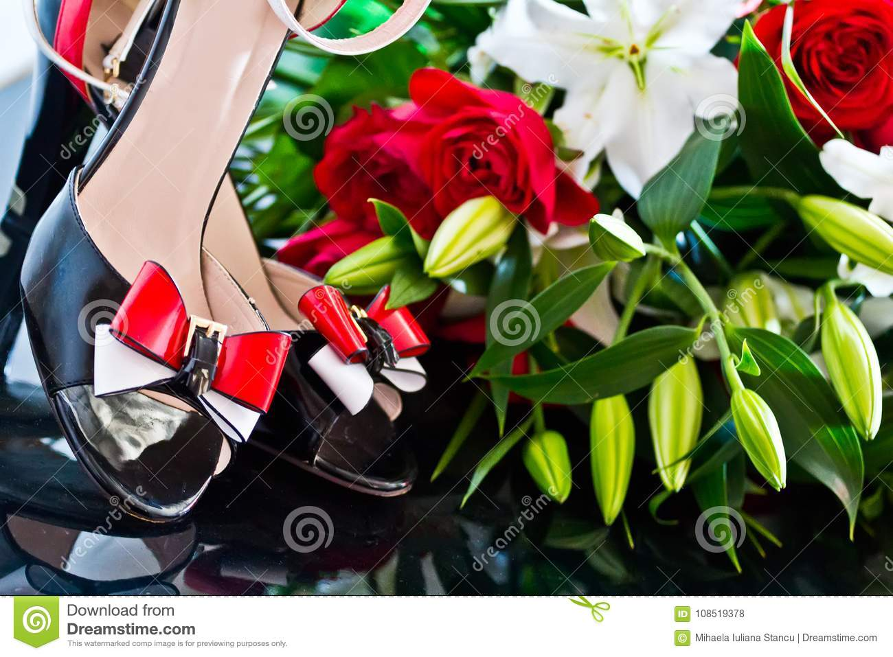 Beautiful Shoes With Red And White Bow Near A Flower Arrangement