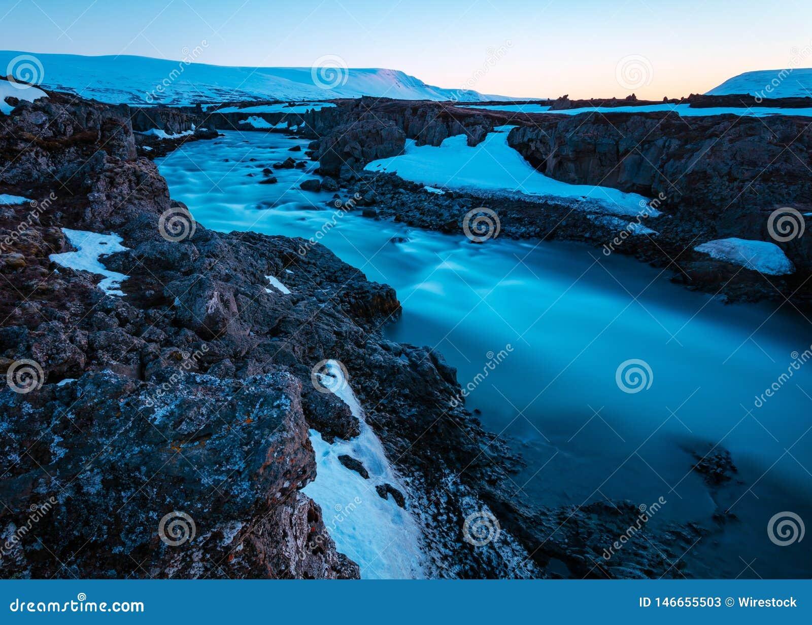 Beautiful shot of a river in a rocky field