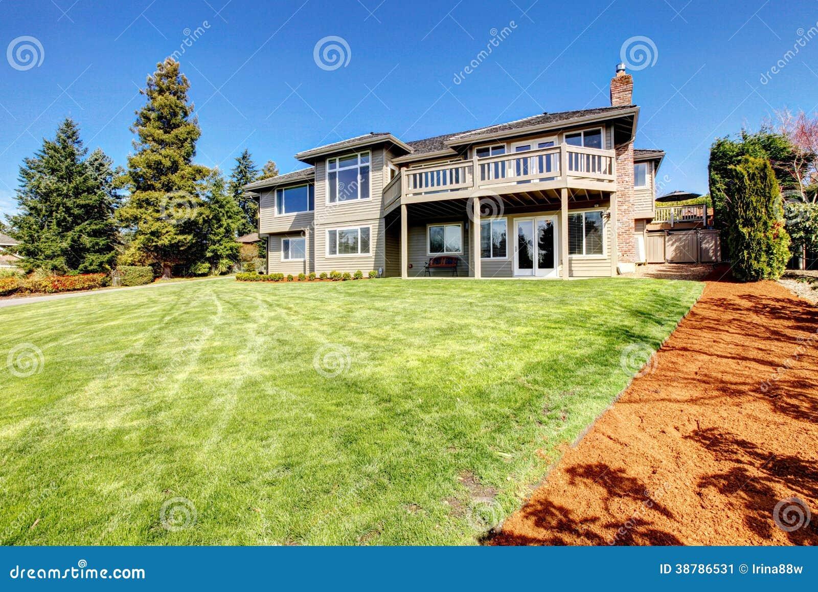 Siding house view backyard clapboard walkout deck back yard green lawn