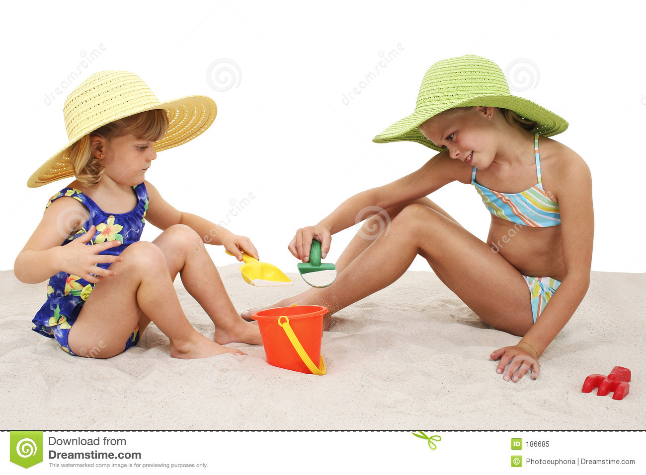 Beautiful Sisters In Beach Hats Playing In The Sand