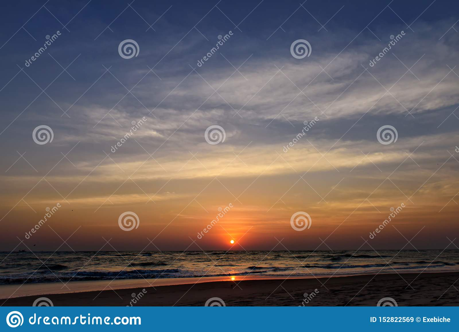 Beautiful sky colorful sunset on the ocean, natural landscapes. Deserted beach, the sun sets in the clouds above the sea