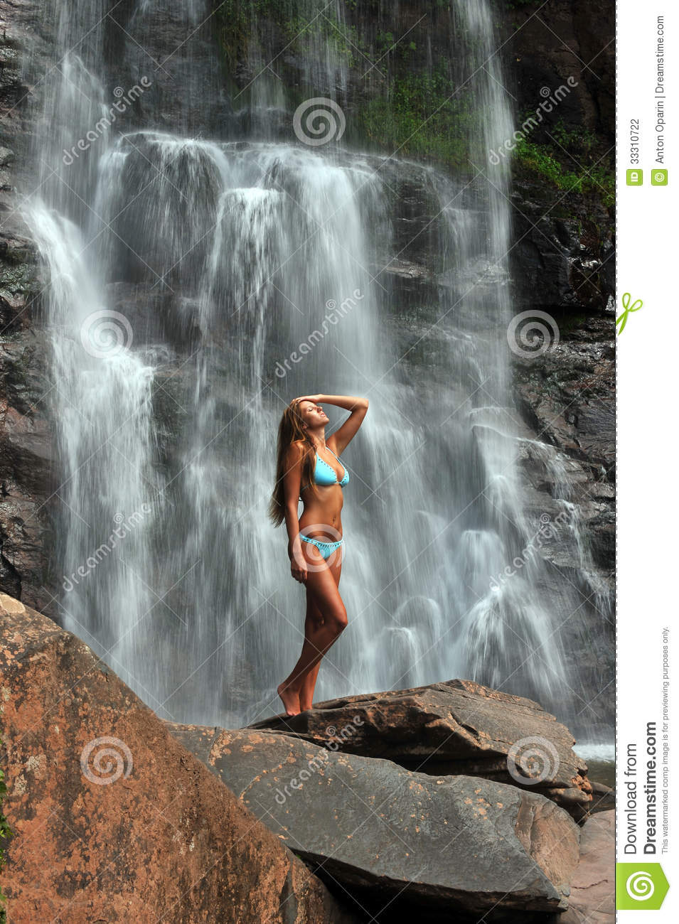 Beautiful Slim Fitness Model Posing In Front Of Waterfalls Stock Photography