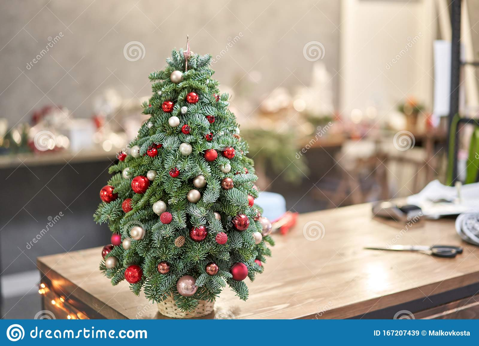 Beautiful Small Christmas Tree On Wooden Table Happy Mood Garland Lamp Bokeh On Background Wallpaper Danish Pine And Stock Image Image Of Feathers Glossy 167207439