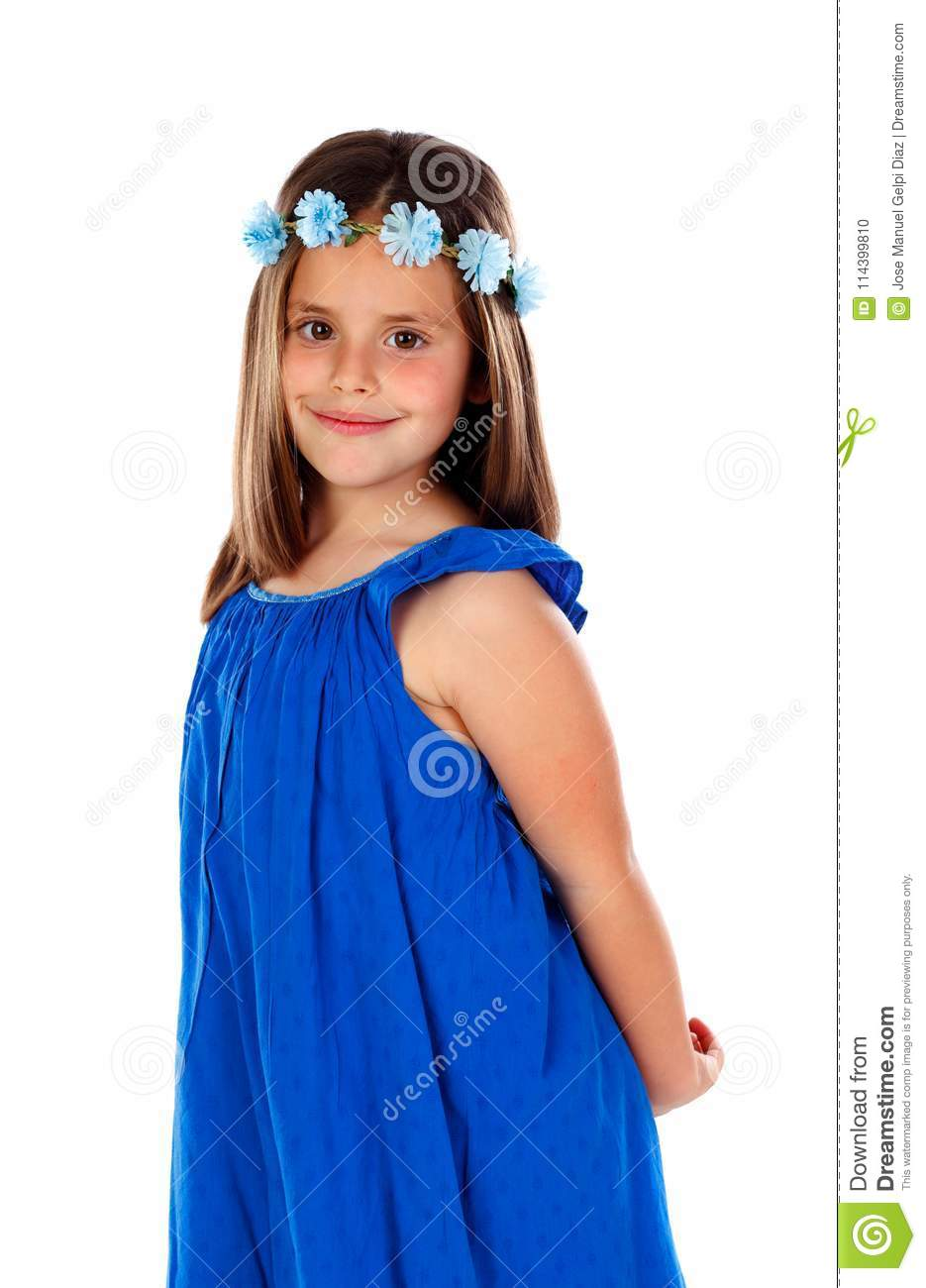 Beautiful Small Girl With Blue Dress And A Flowers Wreath On H