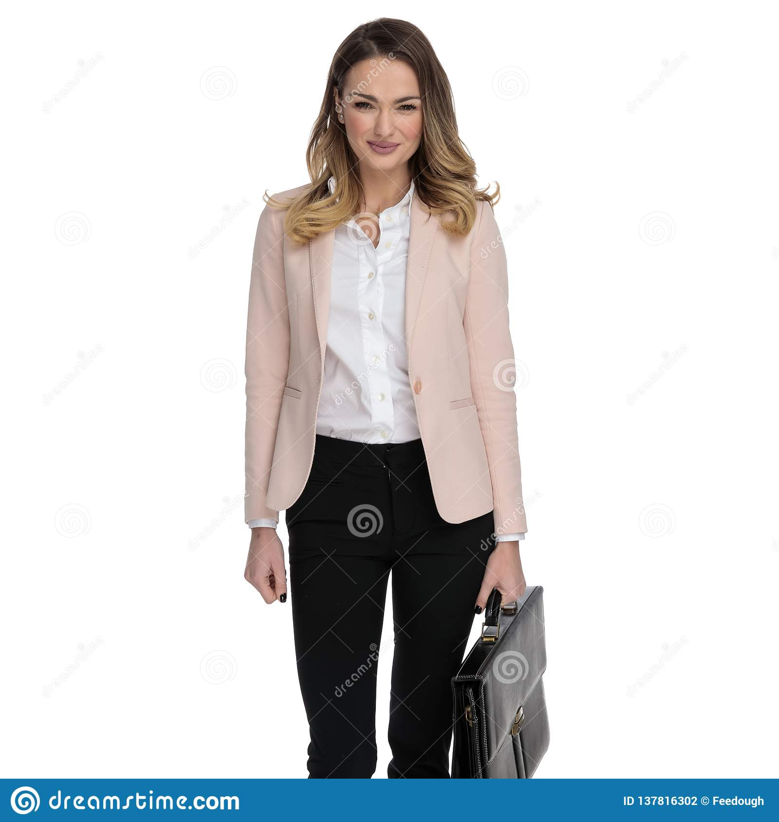 beautiful smart casual woman wearing pink suit and holding