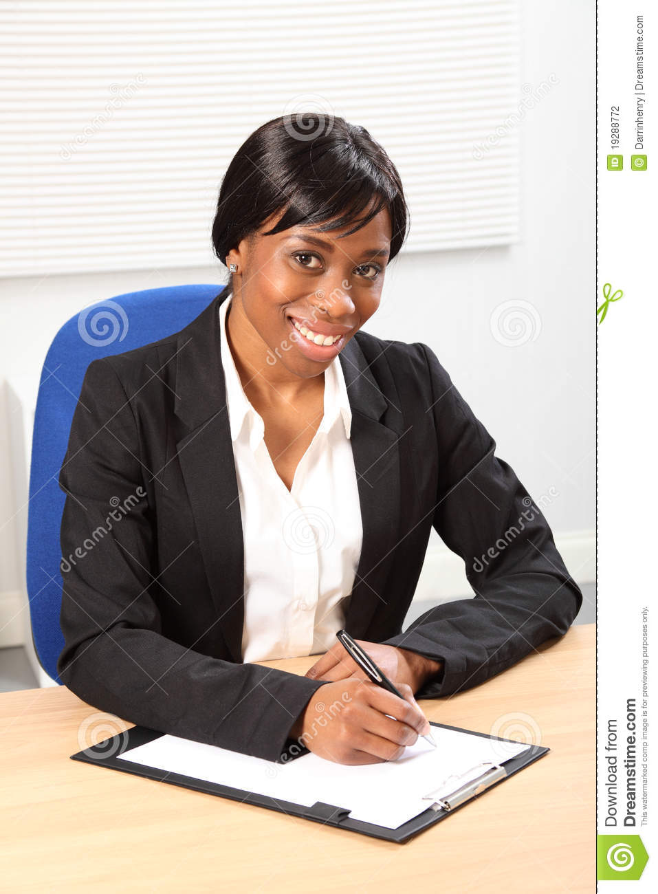 Beautiful smile by black woman in business office