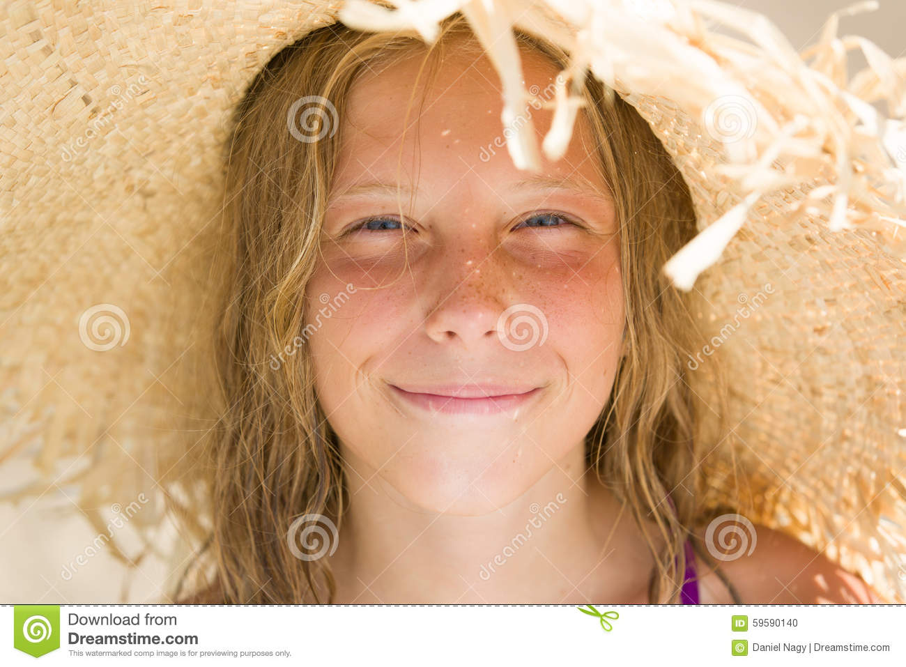 Beautiful smileing young girl with straw hat