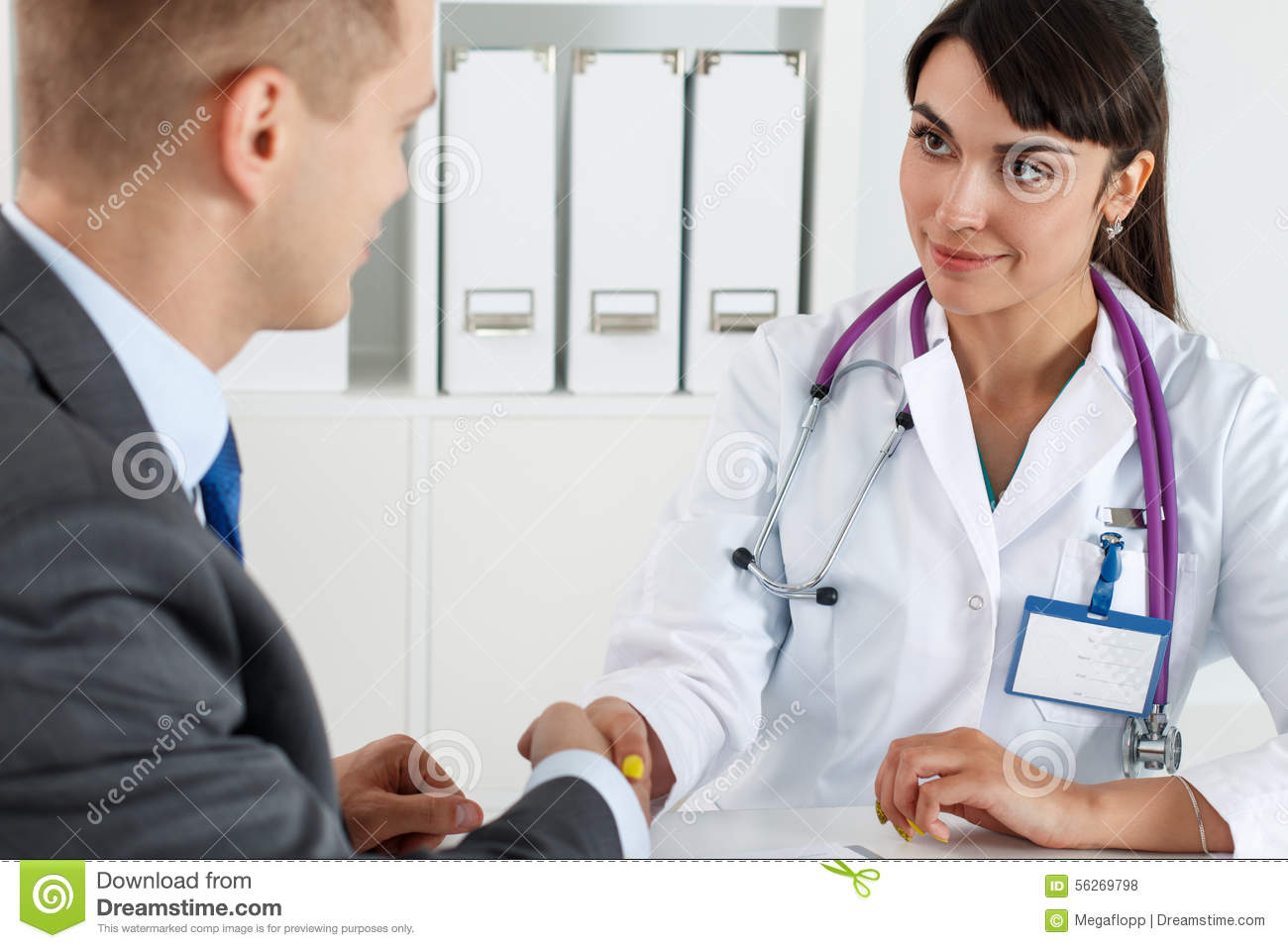 Male Doctor With Female Client Royalty-Free Stock Photo -5763