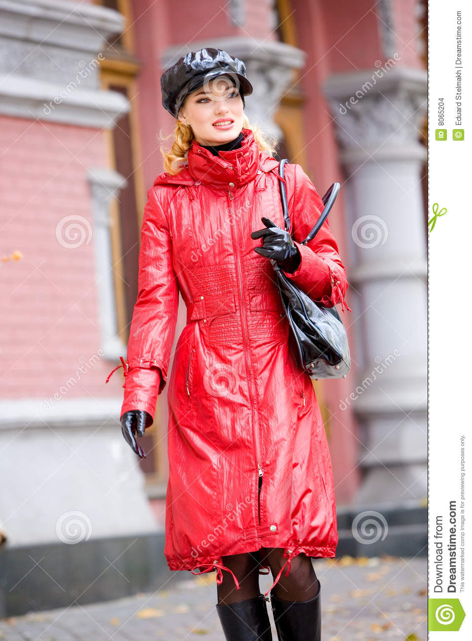 Beautiful smiling girl in red coats and hat