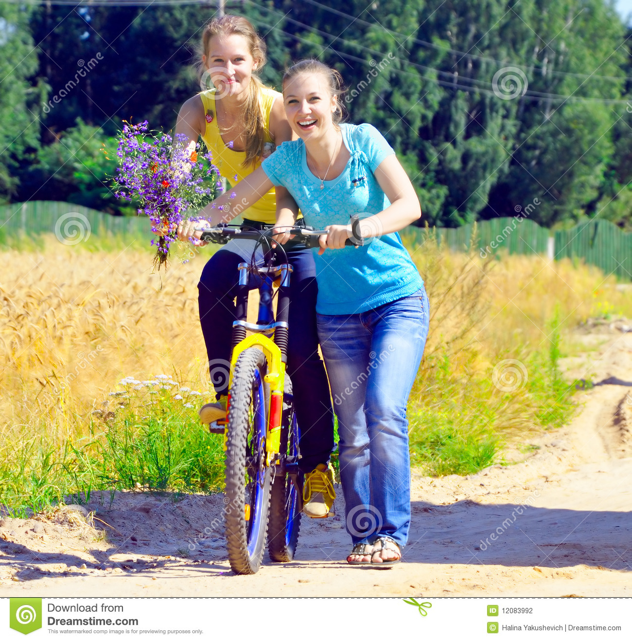 Beautiful Smiling Girls Walk With Bicycle On Villa Stock