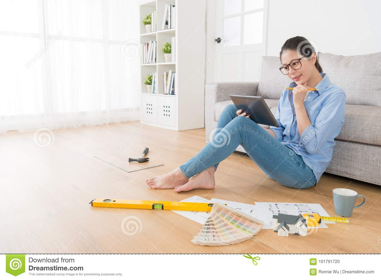 beautiful smiling housewife drawing house interior stock photo