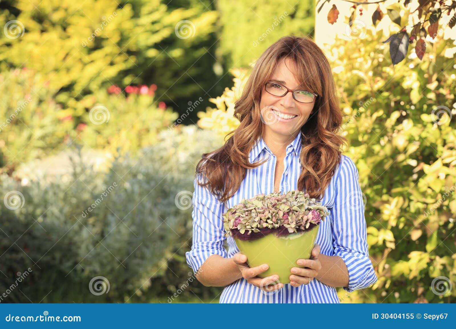 Beautiful Smiling Mature Woman Gardening Royalty Free