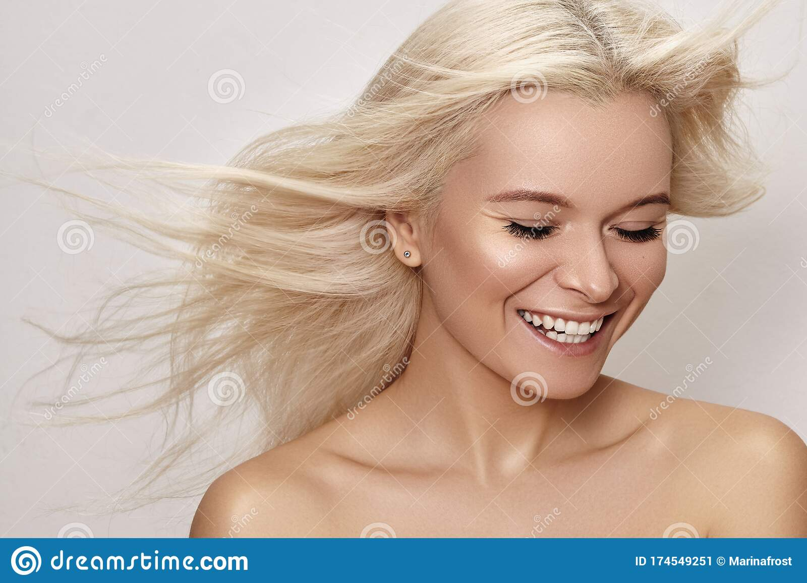 Beautiful Smiling Woman With Magnificent Blond Hair Happy Model With Windswept Flying Hair Shiny Long Health Hairstyle Stock Image Image Of Clean Clear 174549251