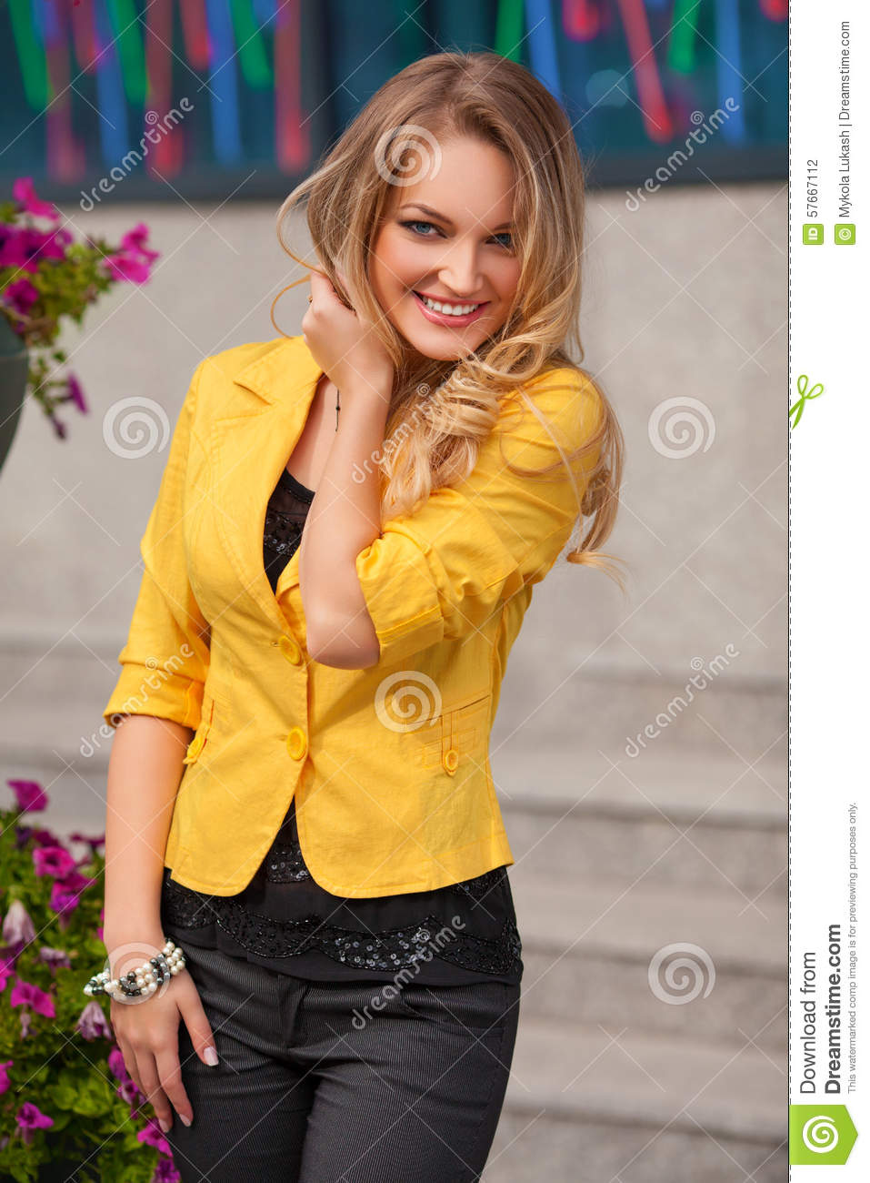 Beautiful Smiling Woman With Yellow Jacket And Blond Hair Posing Outdoor Fashion Girl Stock