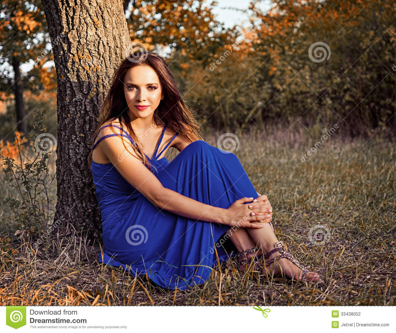 Beautiful Young Hippie Girl Sitting Under The Tree And Playing The ...