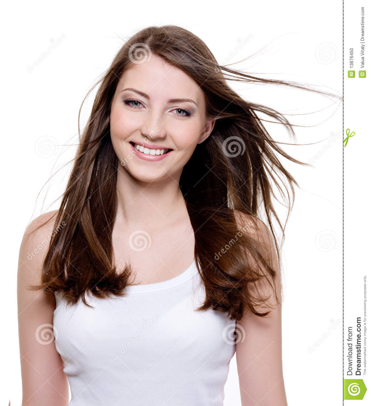 Portrait of happy young woman smiling - a Royalty Free
