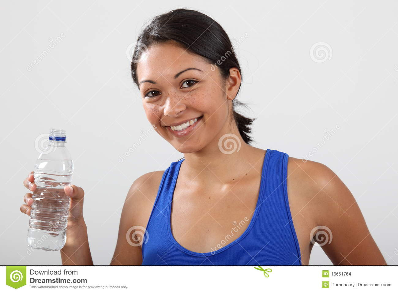 beautiful smiling young woman with bottled water stock