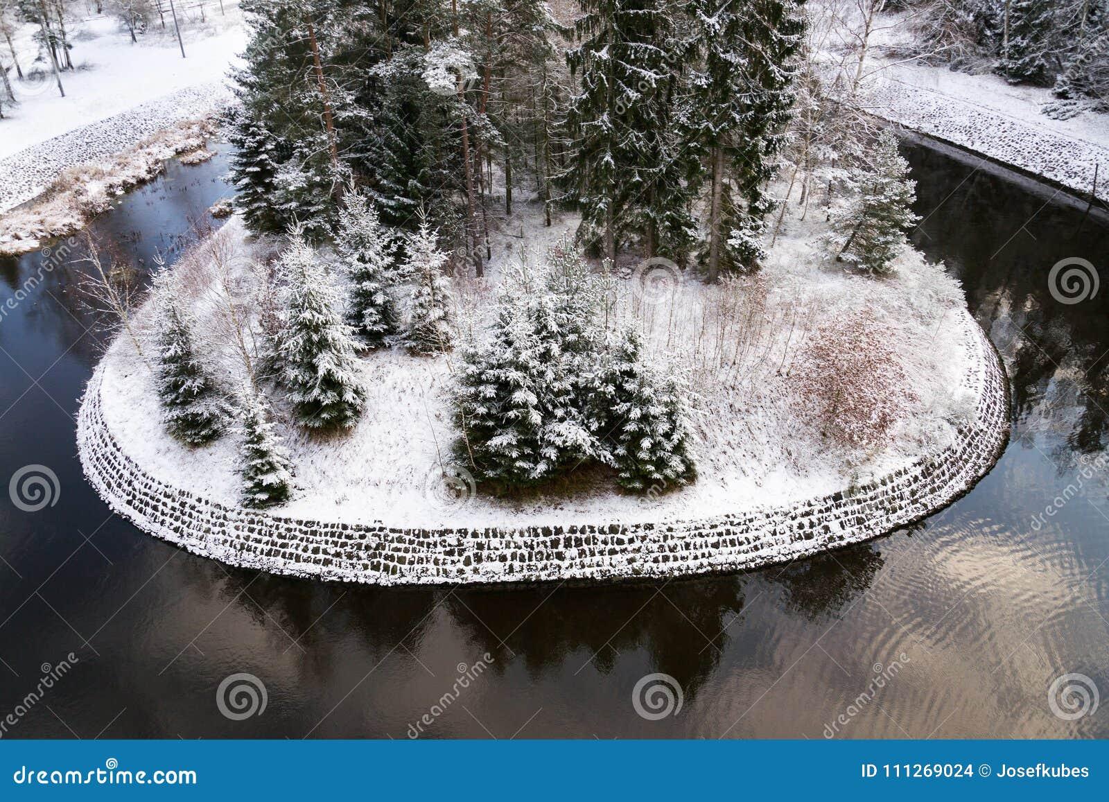 Beautiful snowy winter forest landscape, Tepla River under Brezova dam