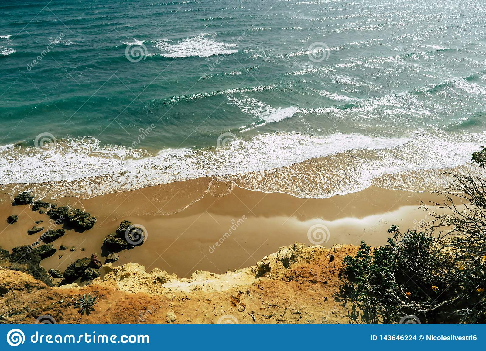 Beautiful spanish beach and coastline with cliffs: Sea, Waves with white crest during sunset