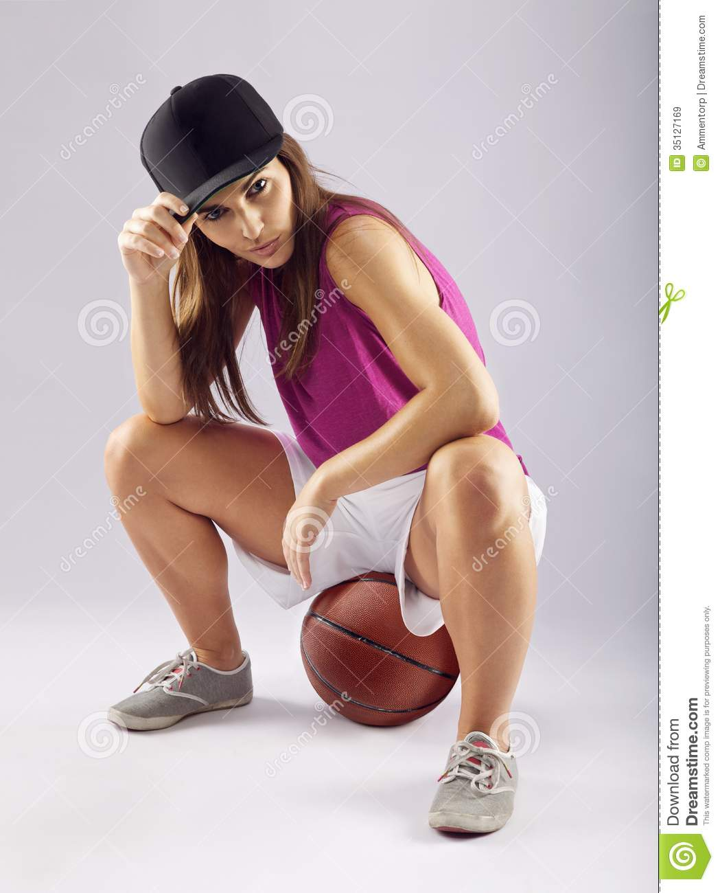 Beautiful and sporty female basketball player