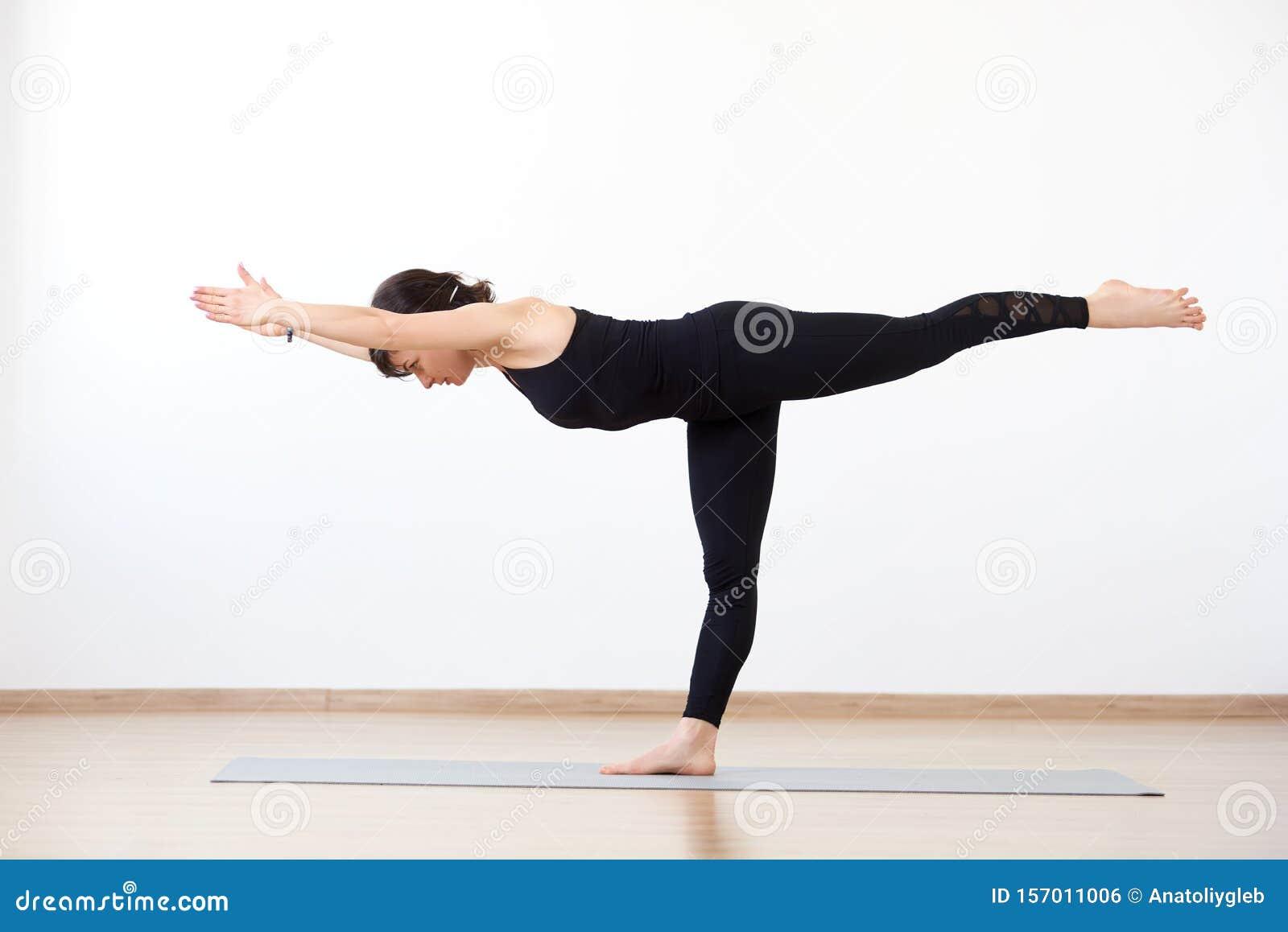 Female Yogi Standing On One Leg. Yoga Asana Warrior 50 Pose ...