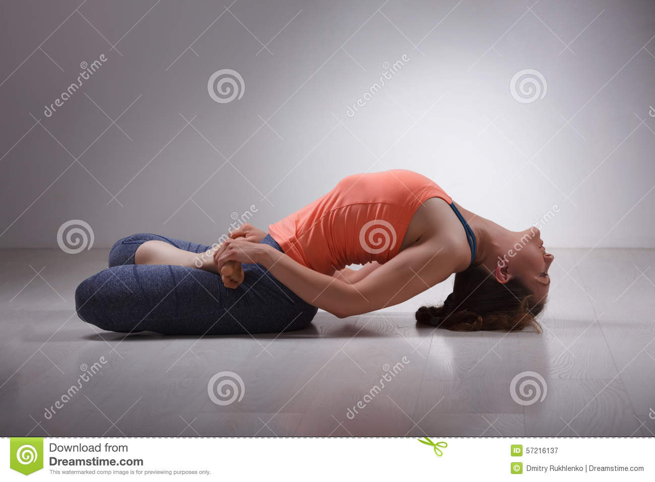 Beautiful sporty fit yogi girl practices yoga