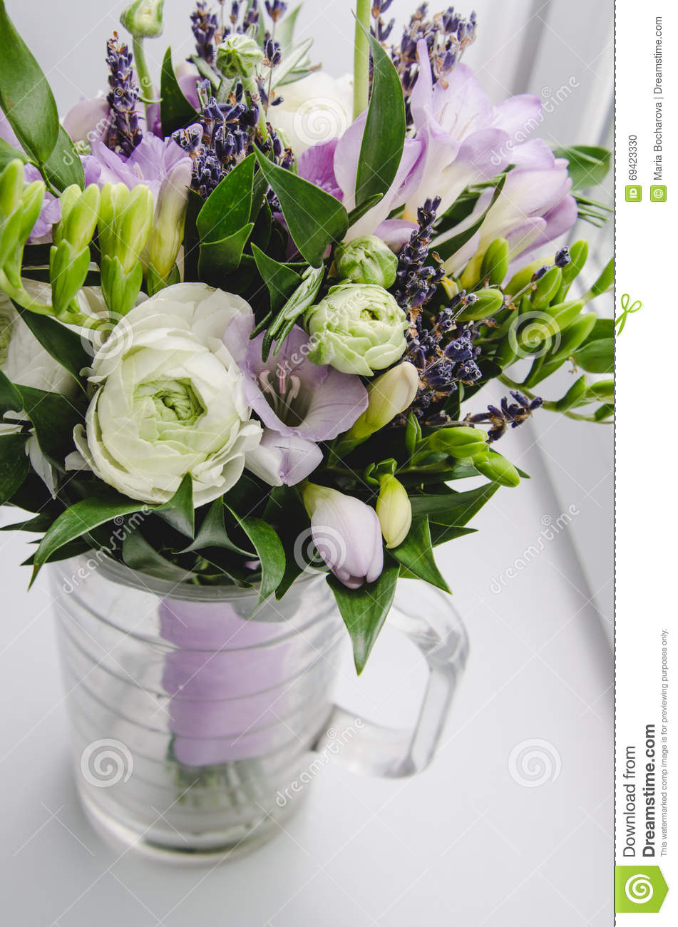 beautiful spring bouquet of wedding flowers buttercup ranunculus fresia lavender in vase with. Black Bedroom Furniture Sets. Home Design Ideas