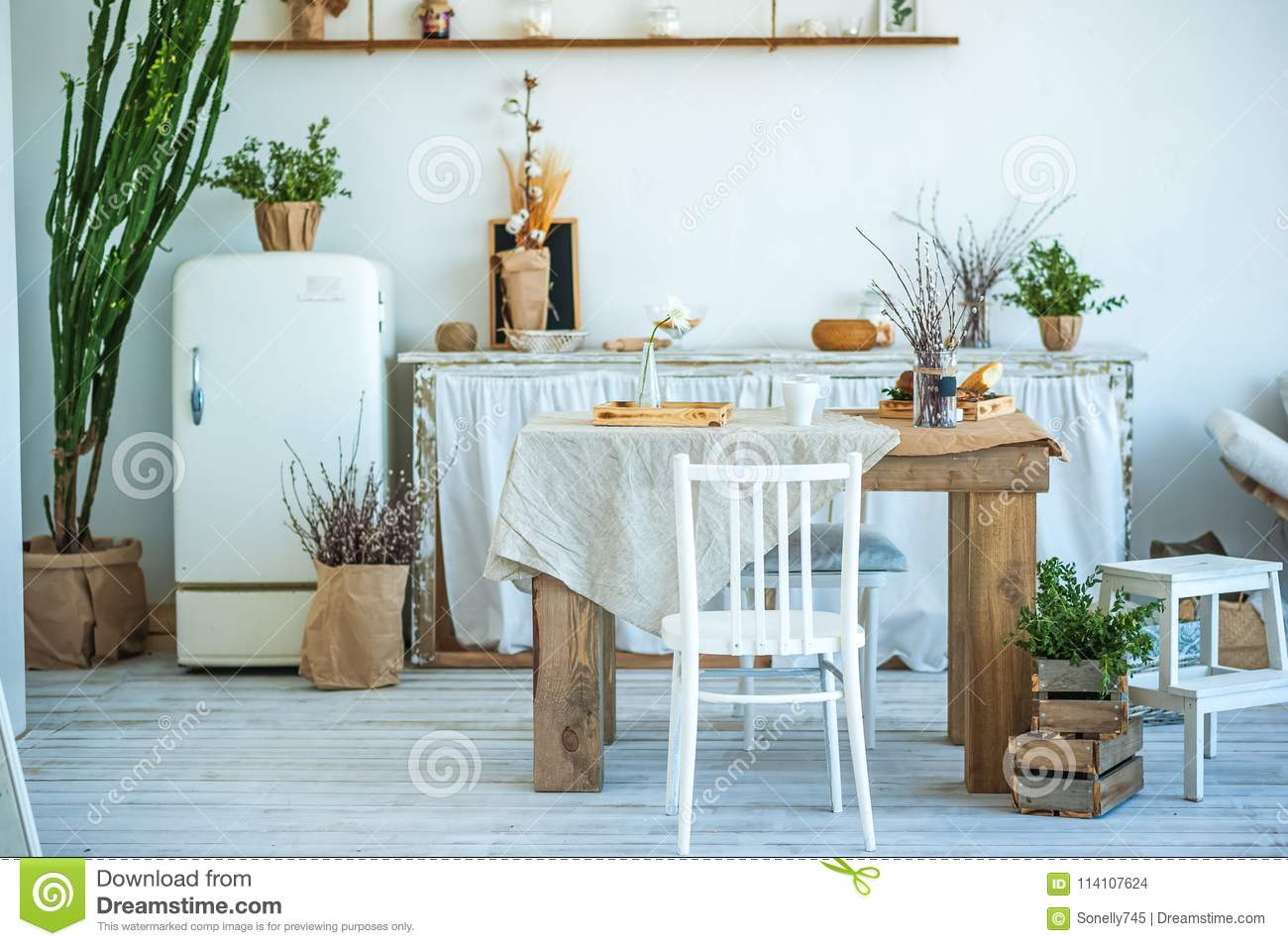 Beautiful Spring Photo Of Kitchen Interior In Light Textured Colors ...