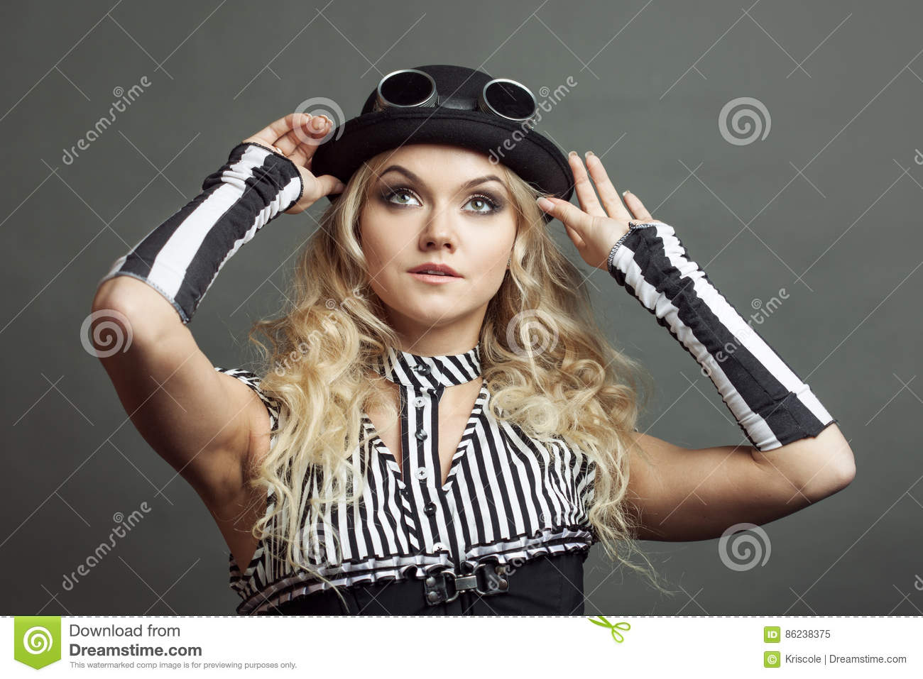 12430f188c0 Beautiful Steampunk Lady In A Victorian Style Wears A Bowler Hat And ...