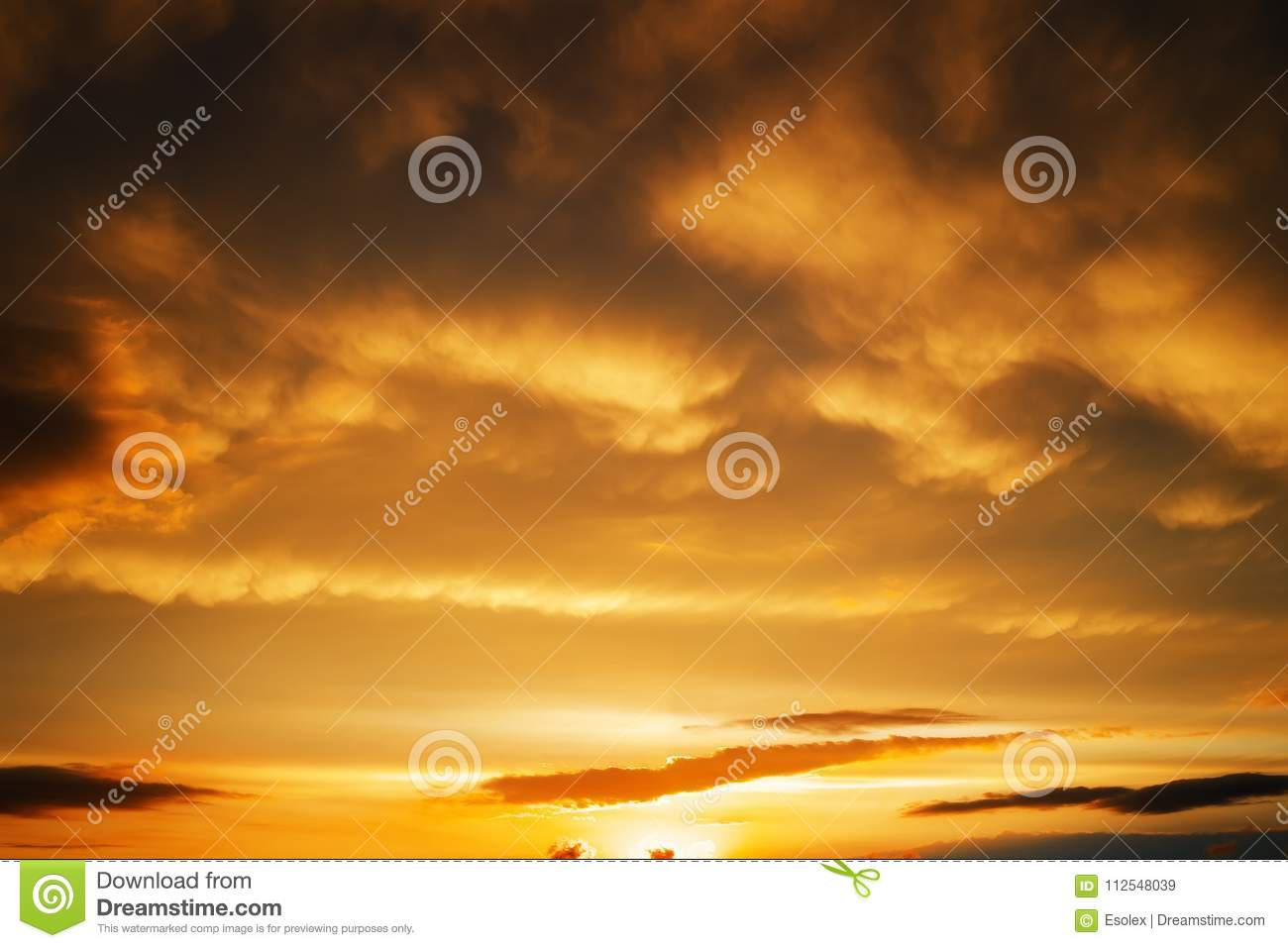 Beautiful stormy sunset sky. Cloudy background.