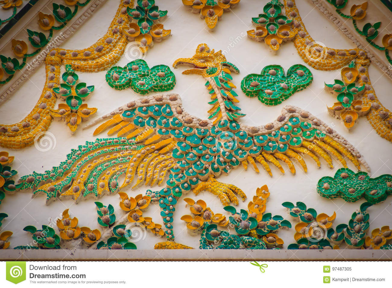 Beautiful stucco of the gable wall with yellow swan decorated wi