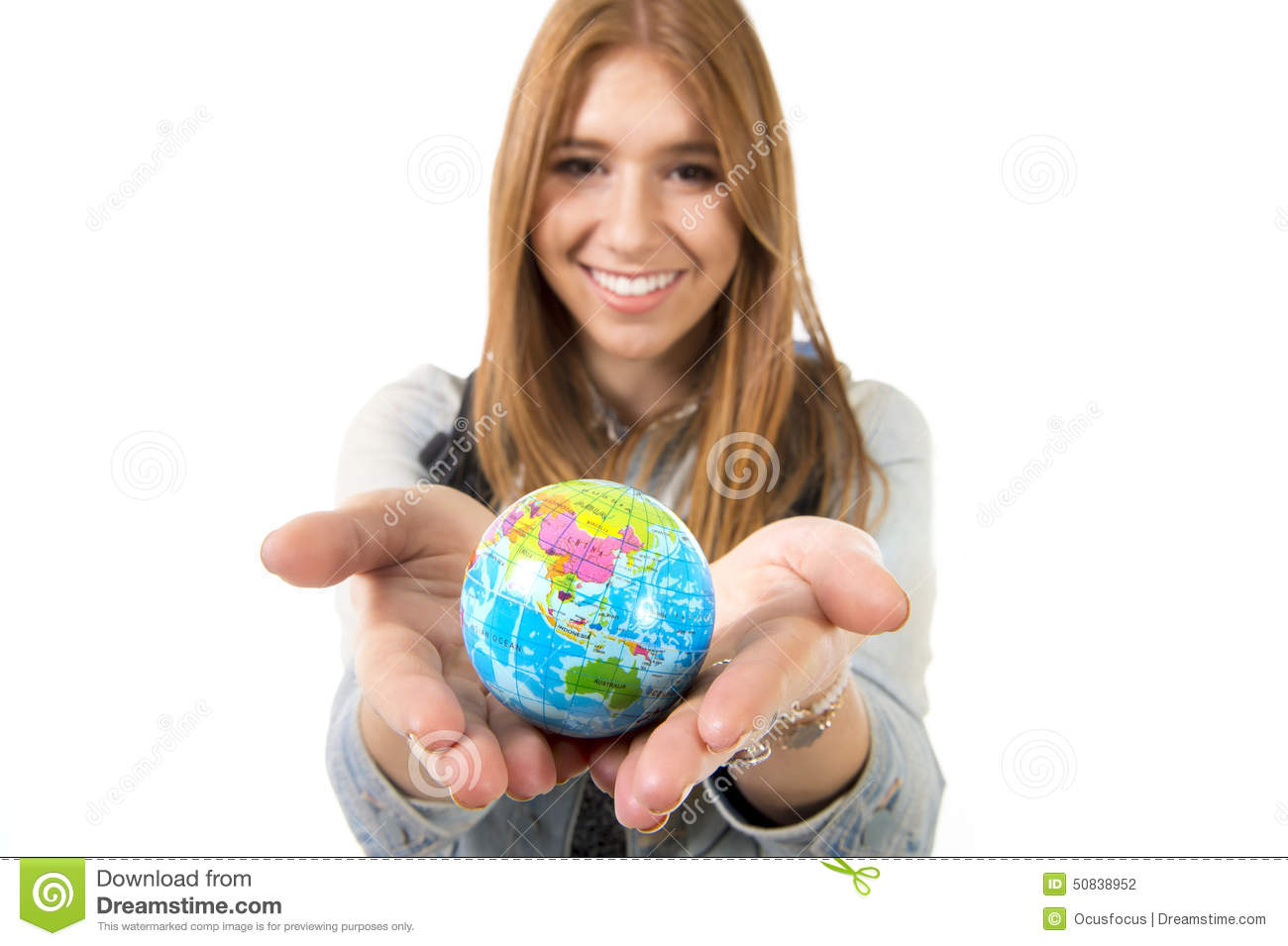 Beautiful student girl holding little world globe in her hand choosing holidays destination in travel tourism concept