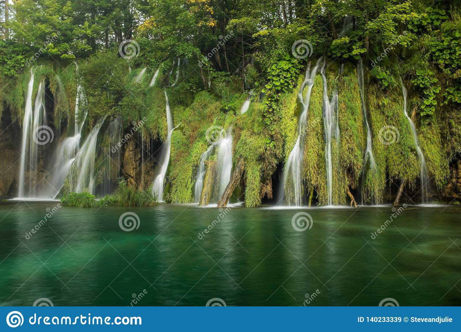 The beautiful and stunning Plitvice Lake National Park, Croatia, wide shot of a waterfall