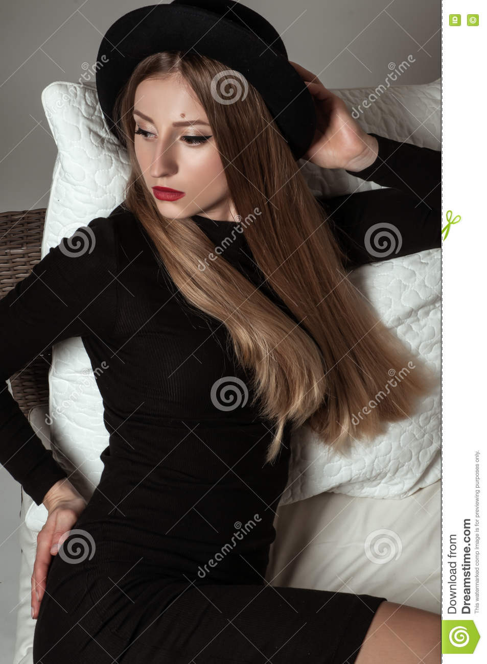 Black dress hairstyle - Beautiful Stylish Woman With Blonde Long Hair In Black Dress And Hat Stock Photo