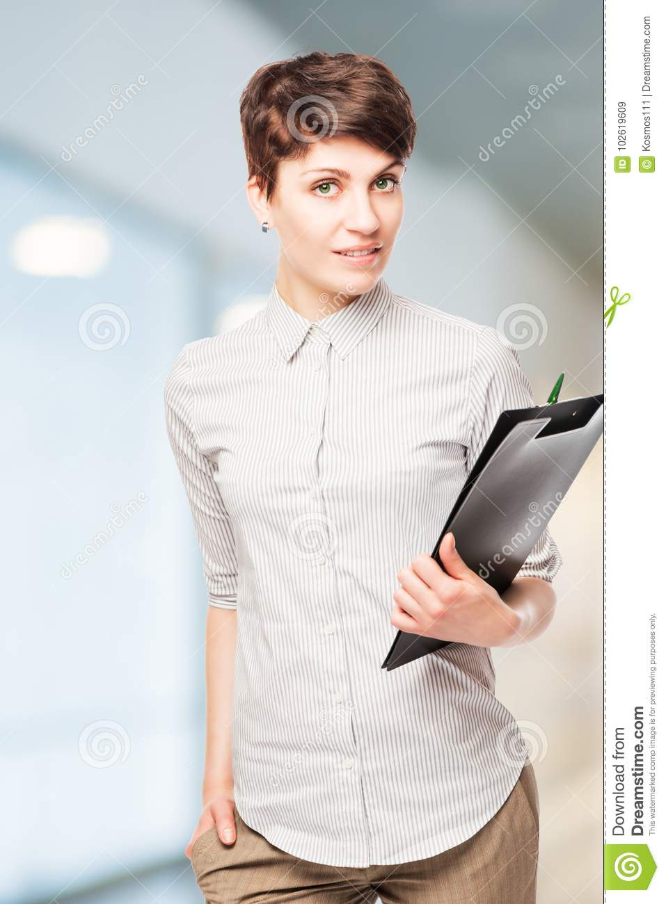 beautiful successful woman office worker with a folder