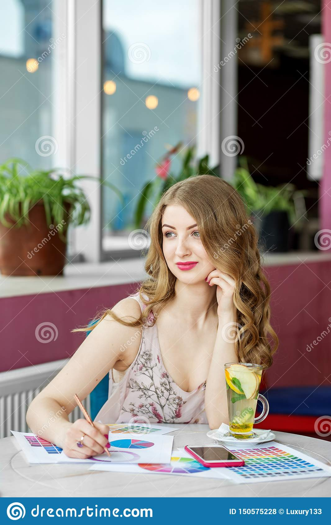 Beautiful successful woman working remotely. Citrus tea with mint. The concept of work, business, education, freelance, lifestyle