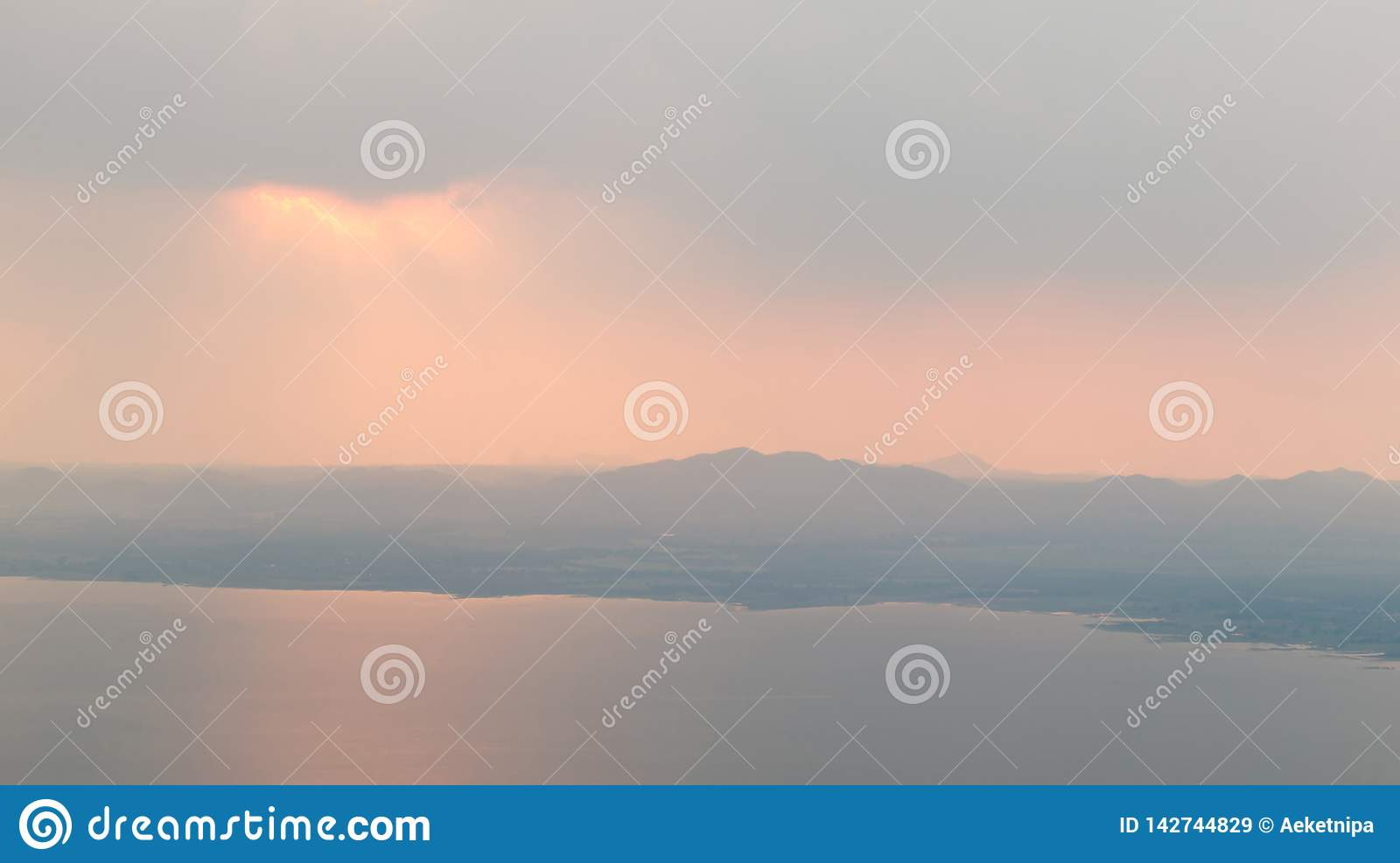 Beautiful Sun Rays Through the Clouds Over Mountains and Dam