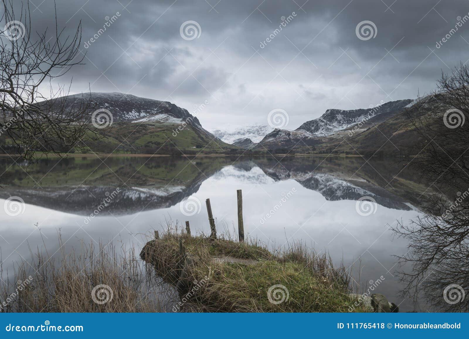Beautiful Winter landscape image of Llyn Nantlle in Snowdonia Na