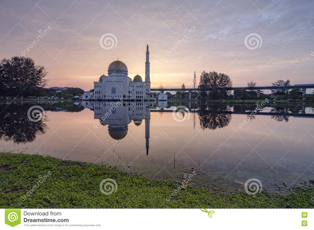 Beautiful sunrise scenery of As-Salam Mosque located in Selangor, Malaysia with reflecton on the lake