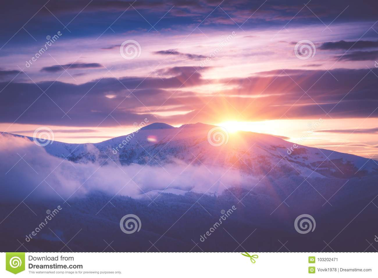 Beautiful sunrise in the winter mountains. Filtered im