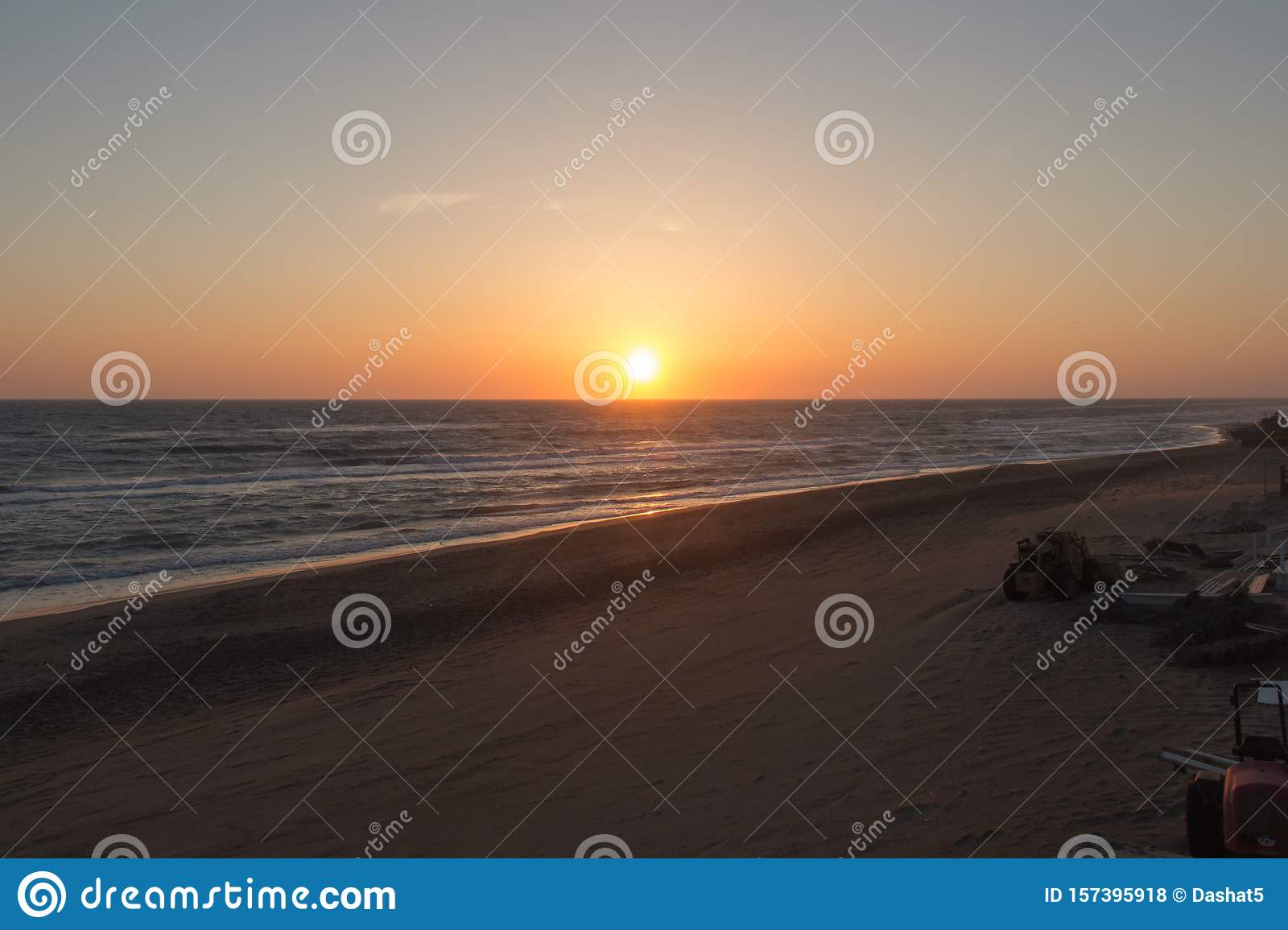 Beautiful sunset on a beach. The sun sets over Tyrrhenian sea