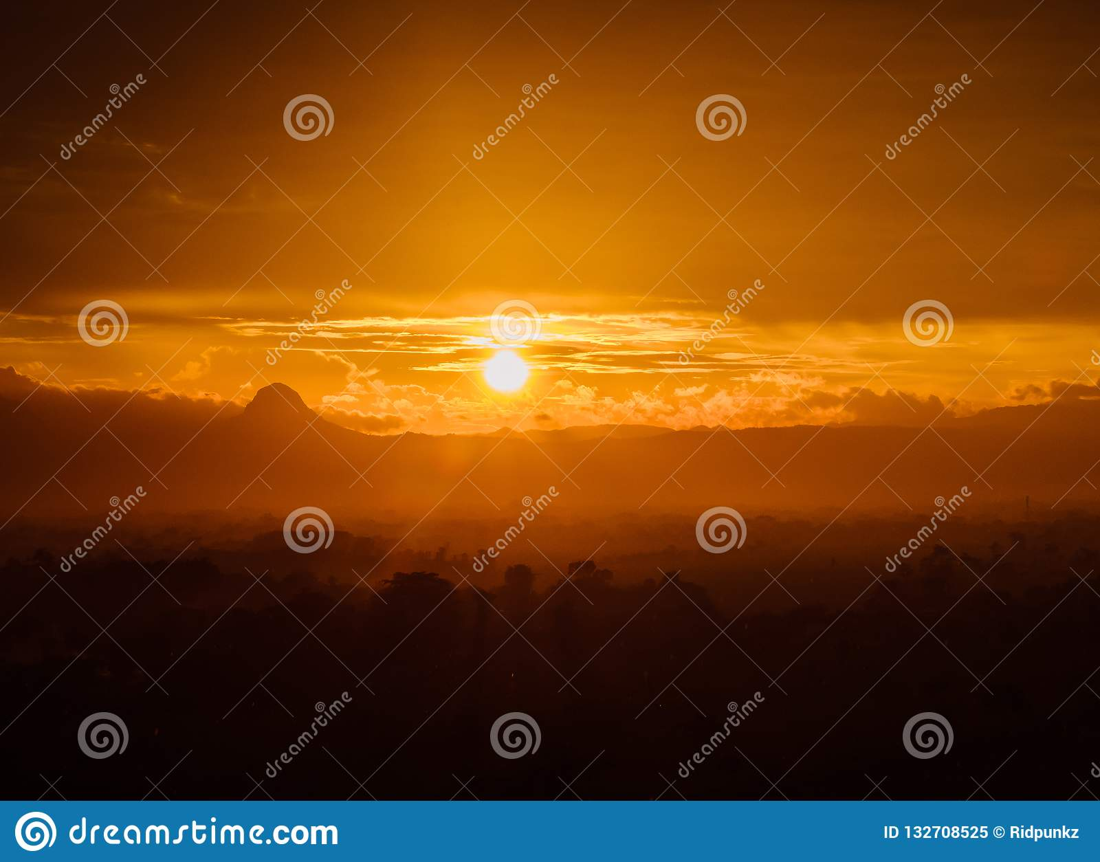 Beautiful Sunset, cloud, mist, and mountain scene in golden color.
