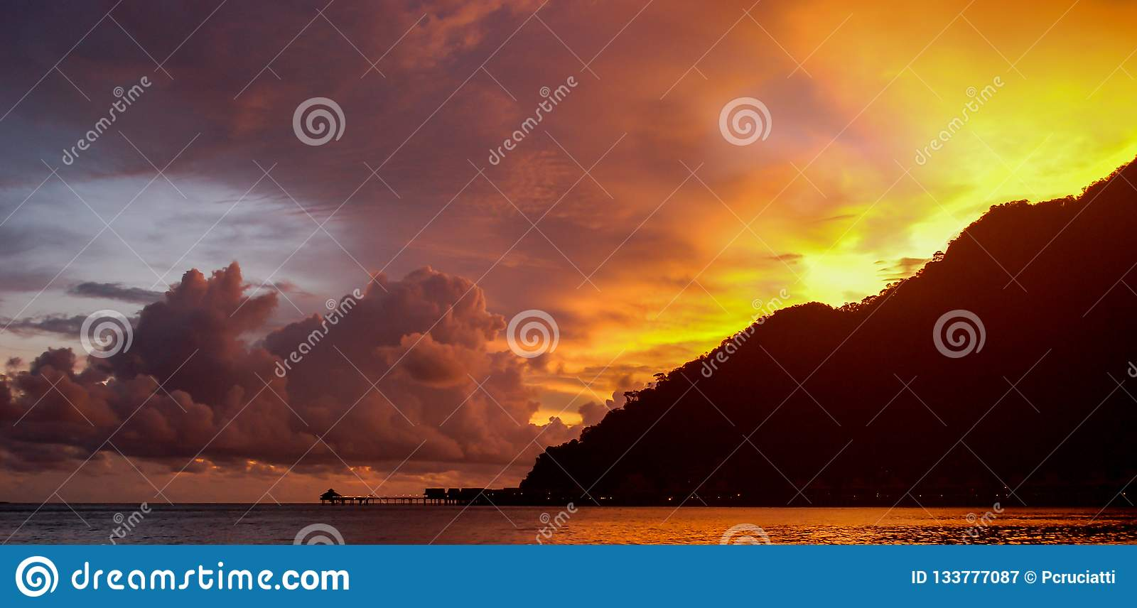 Beautiful Sunset And Dramatic Sky On A Resort Beach In
