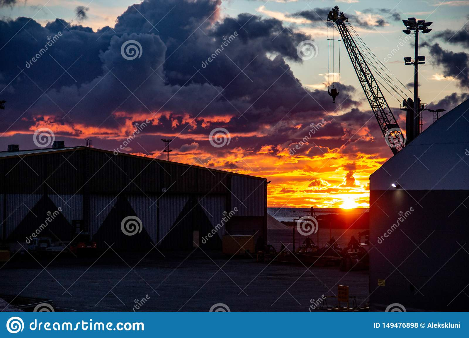 Beautiful sunset with fiery clouds in North Finland. Port area.