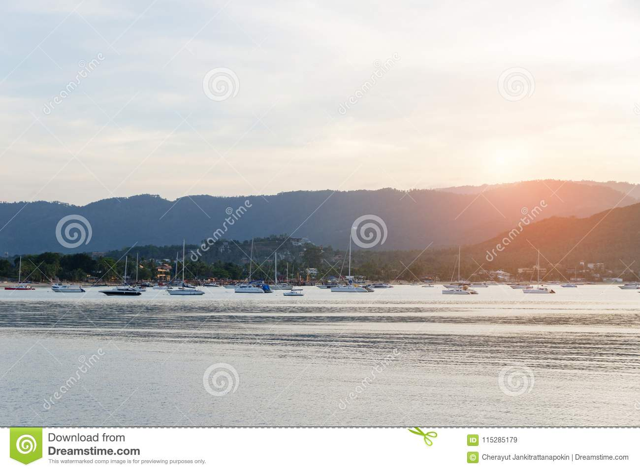 Beautiful sunset with mountain and speed boat, yacht at pier over horizon summer sea background evening.