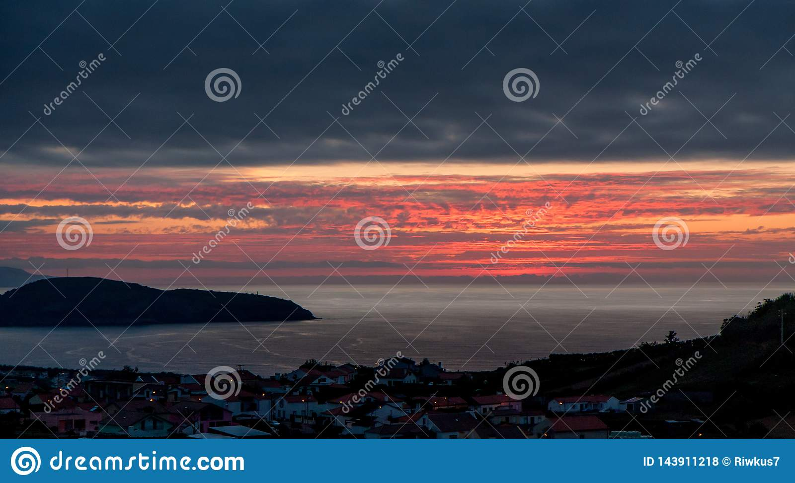 Beautiful sunset over the city by the sea