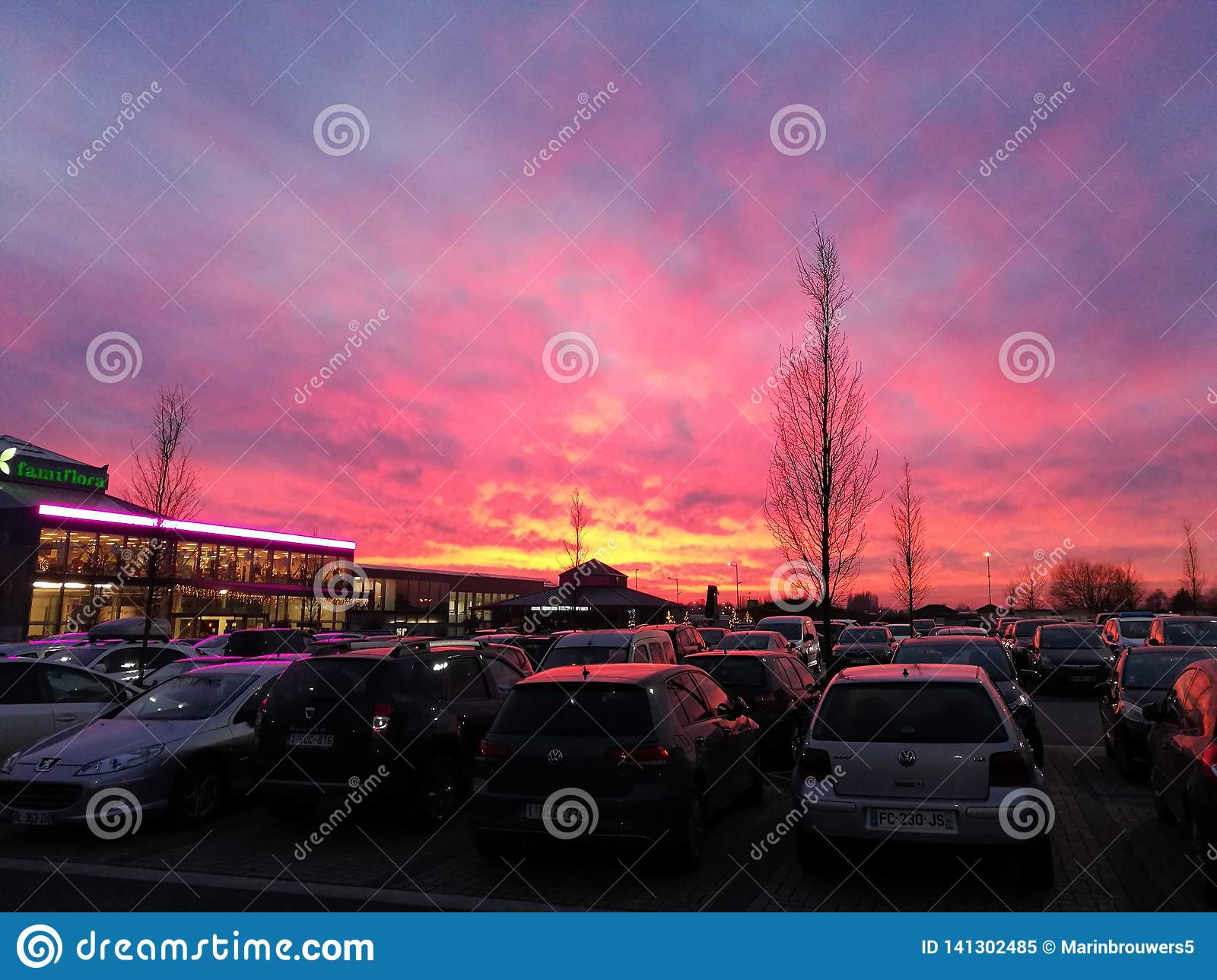 Beautiful sunset over a parking lot.