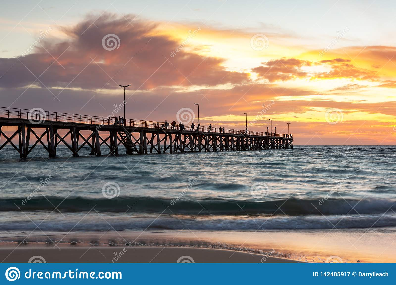 A beautiful sunset at Port Noarlunga with the jetty and motion blur on the water at Port Noarlunga South Australia on 18th March