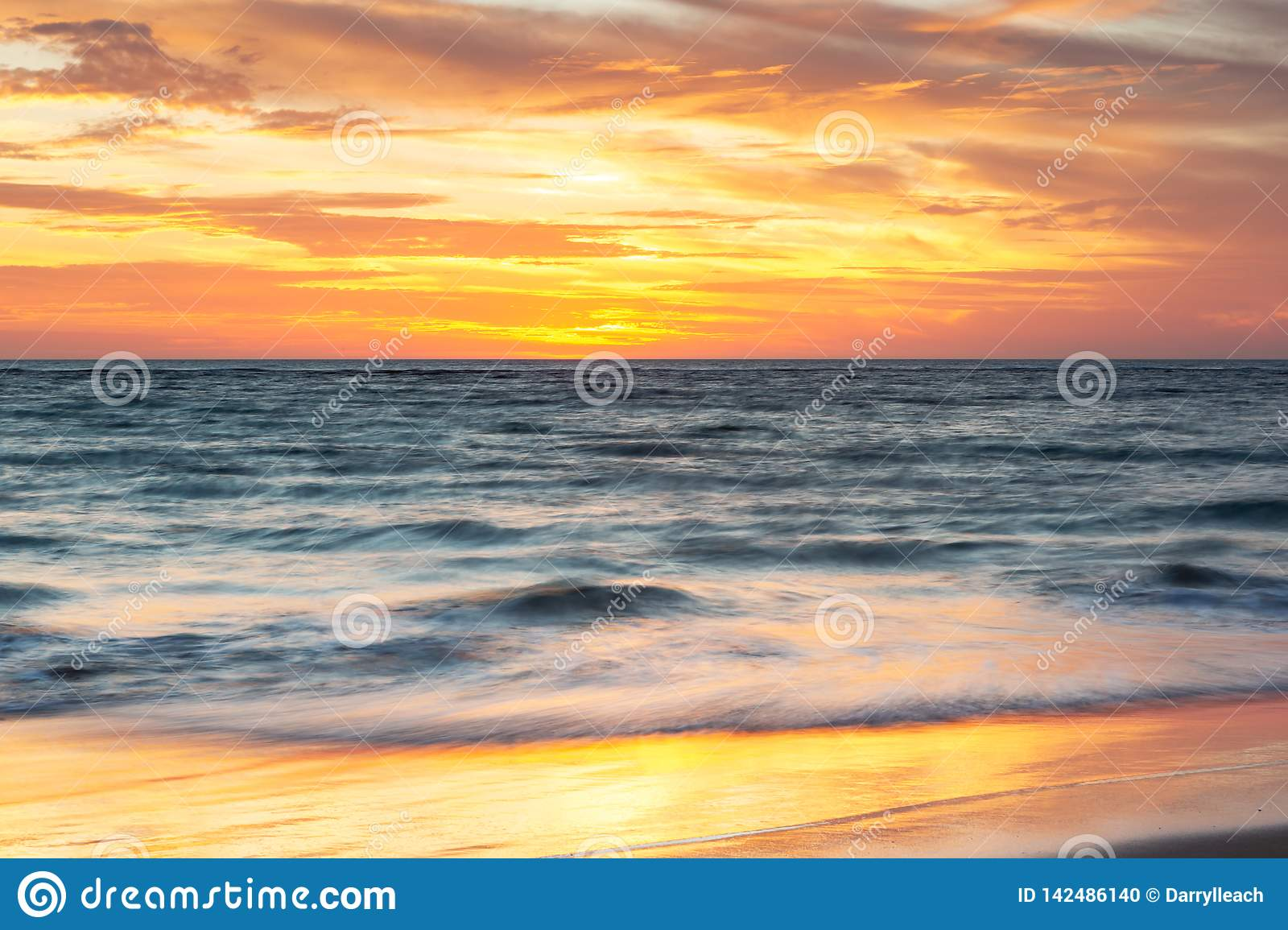 A beautiful sunset at Port Noarlunga with sunset reflections on the sand at Port Noarlunga South Australia on 18th March 2019